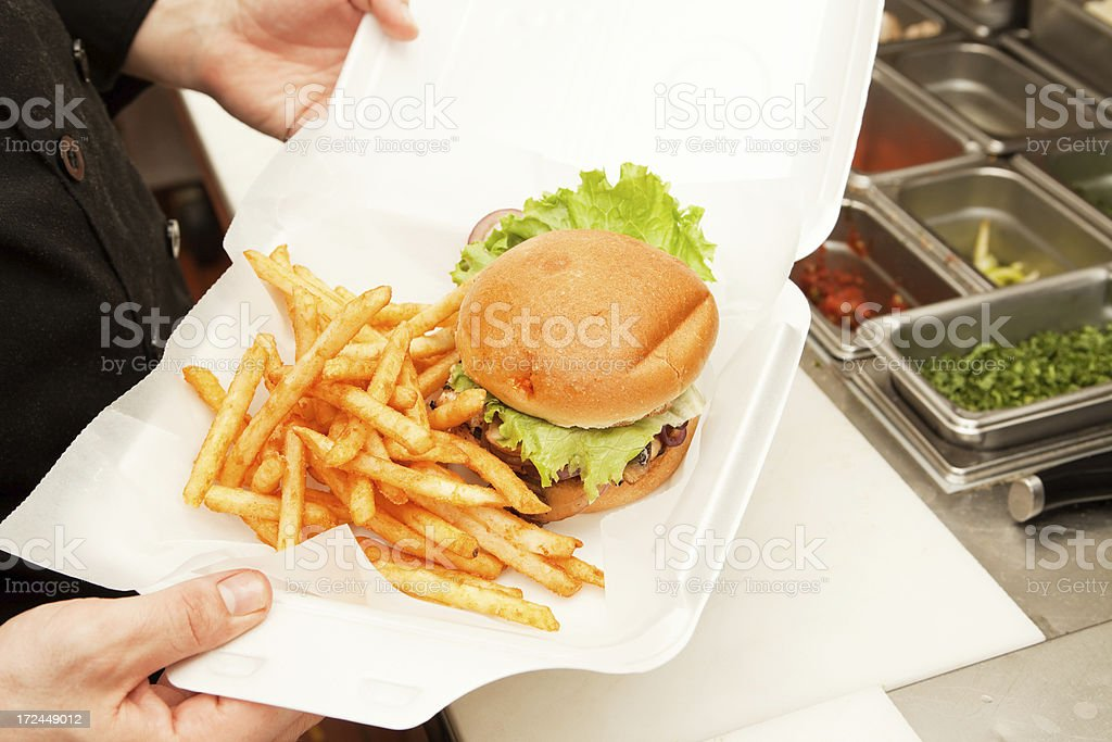 To Go, Chicken Sandwich and Fries in a Clamshell Container stock photo
