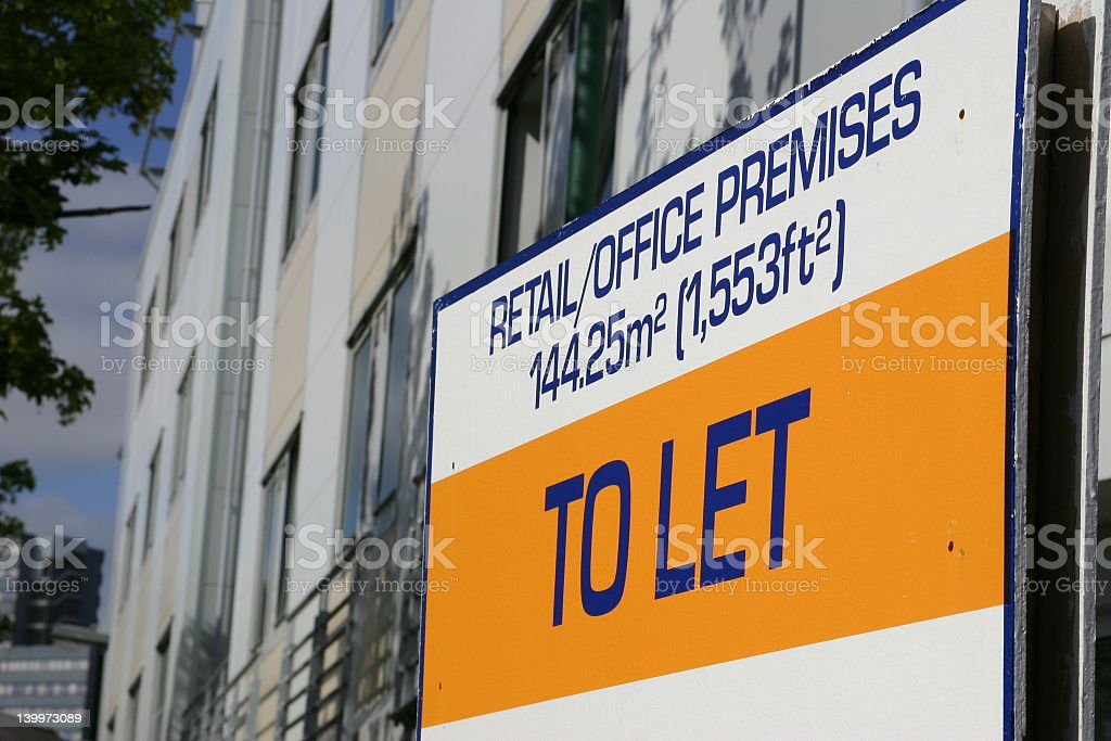 To let sign on building angled side picture stock photo