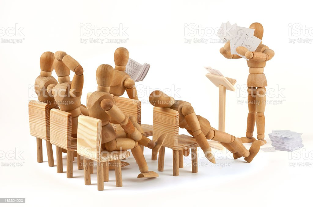To much information - boring meeting of wooden mannequins stock photo