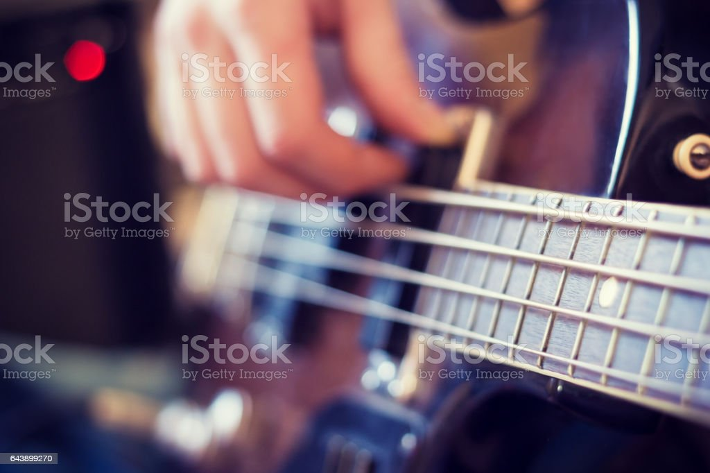 To play bass guitar stock photo
