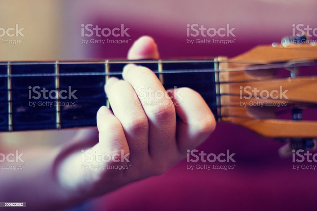 to play guitar stock photo