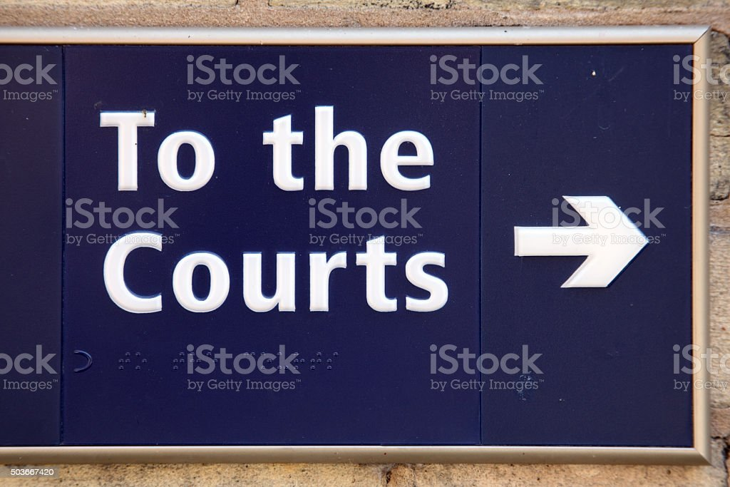 To the law courts sign stock photo