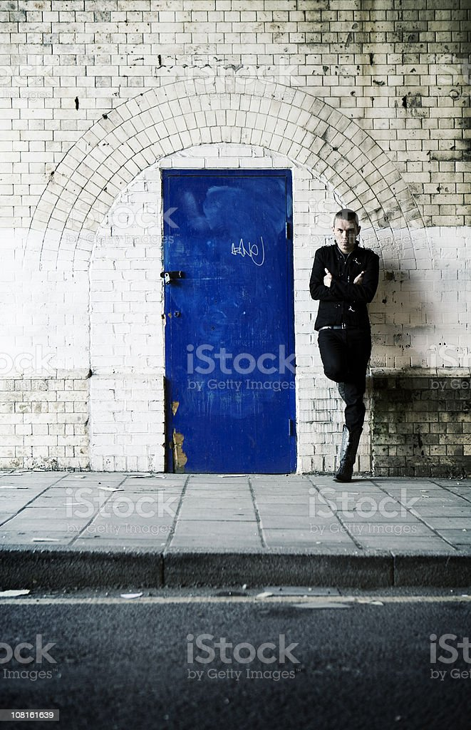 to the wrong side of the blue door stock photo
