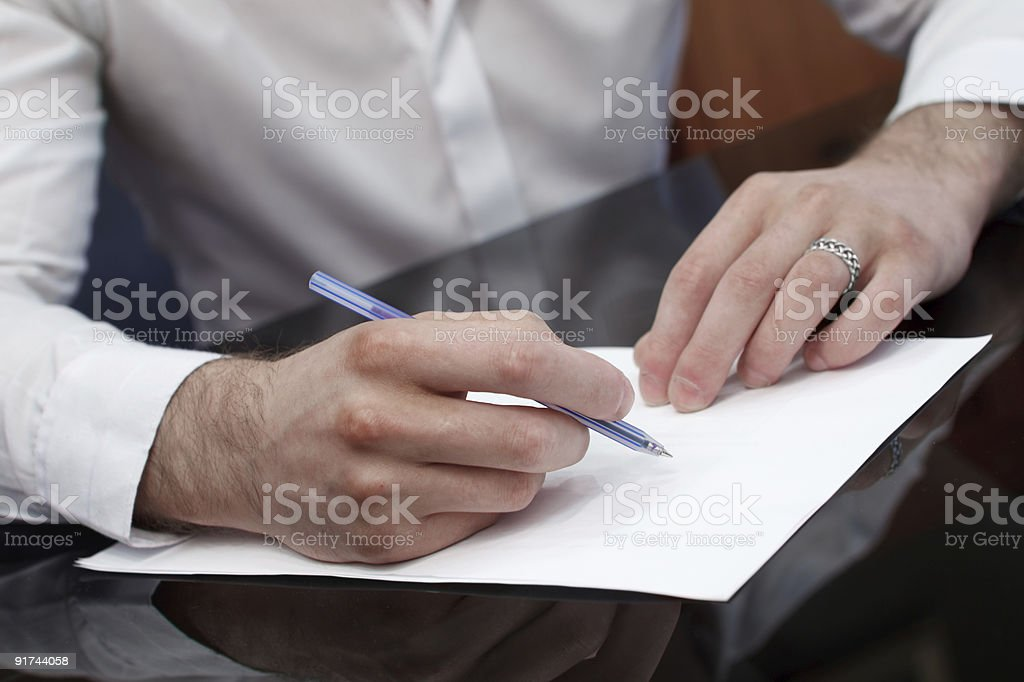 To write brief at the table. stock photo