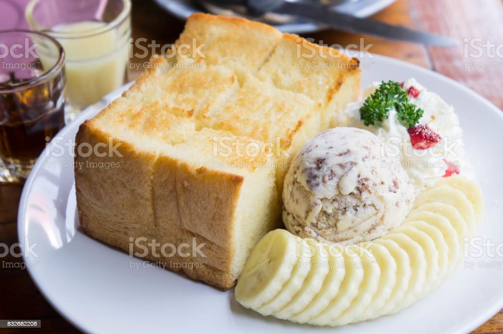Toast and ice cream and banana dessert in cafe stock photo