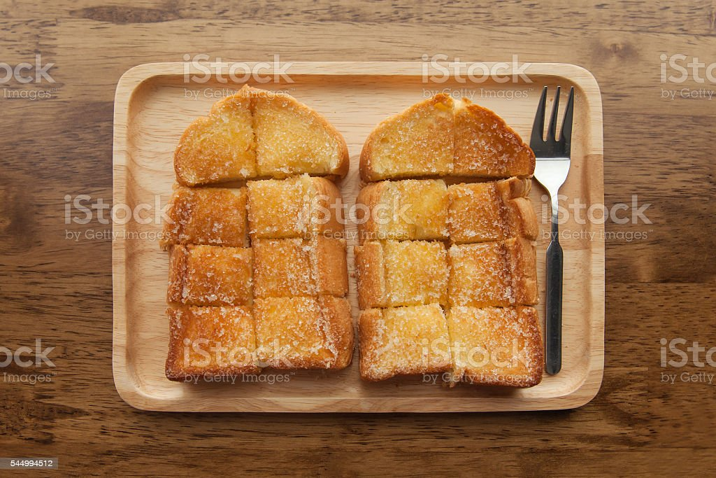 Toast bread on wooden background closeup stock photo