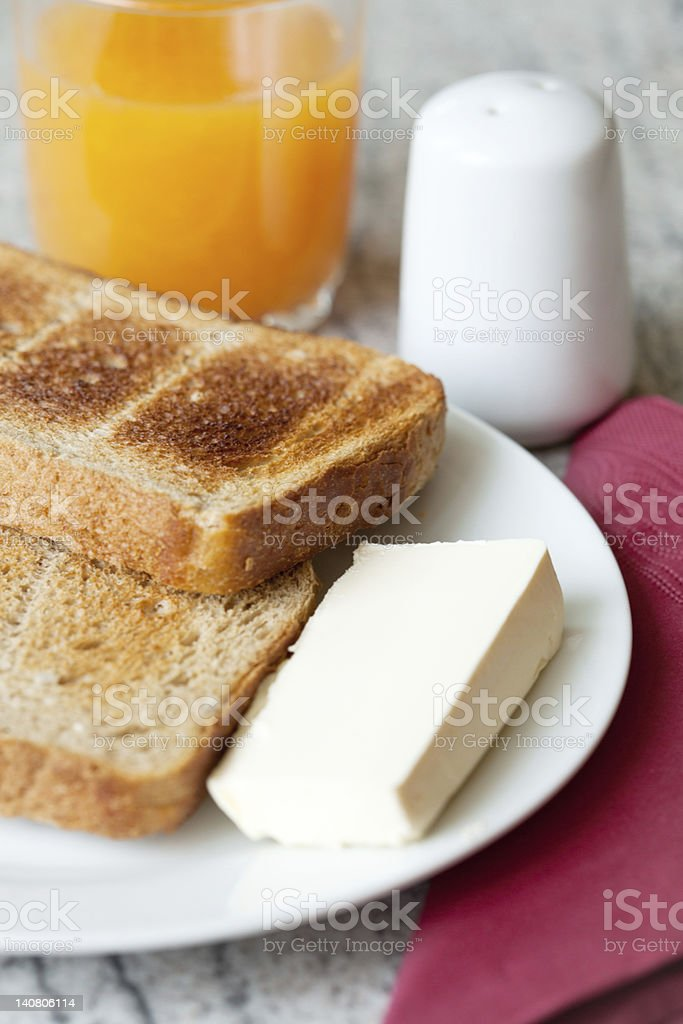 Toast, butter and orange juice for breakfast royalty-free stock photo
