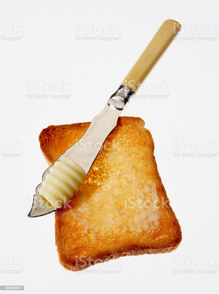 Toast & butter knife. royalty-free stock photo