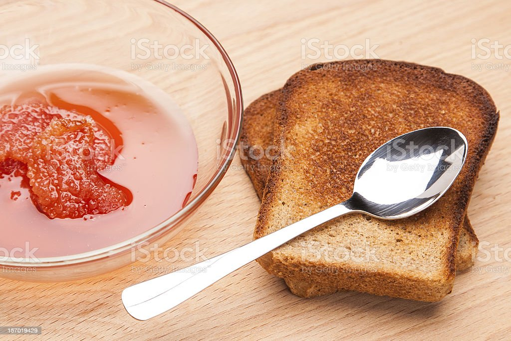 toast from bread with jam and spoon royalty-free stock photo
