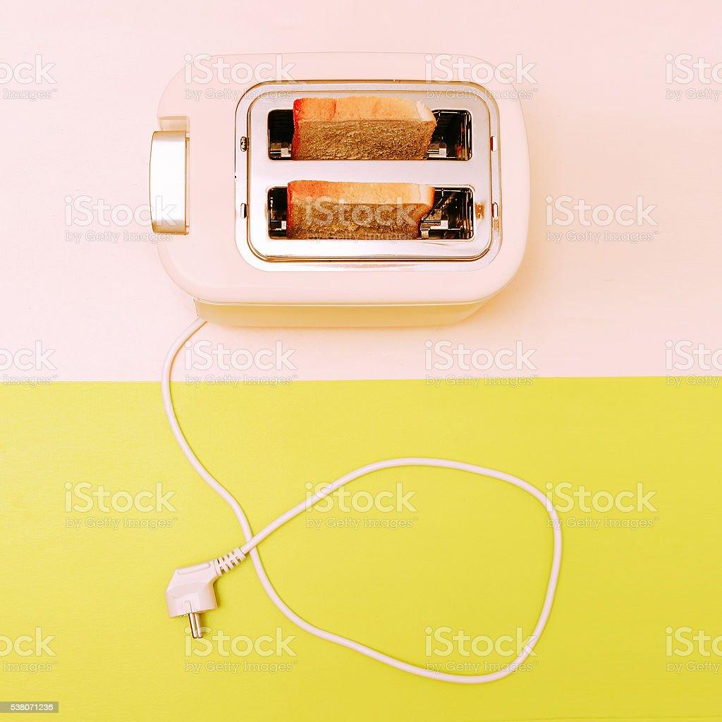 Toast in the toaster. Minimal fashion style stock photo