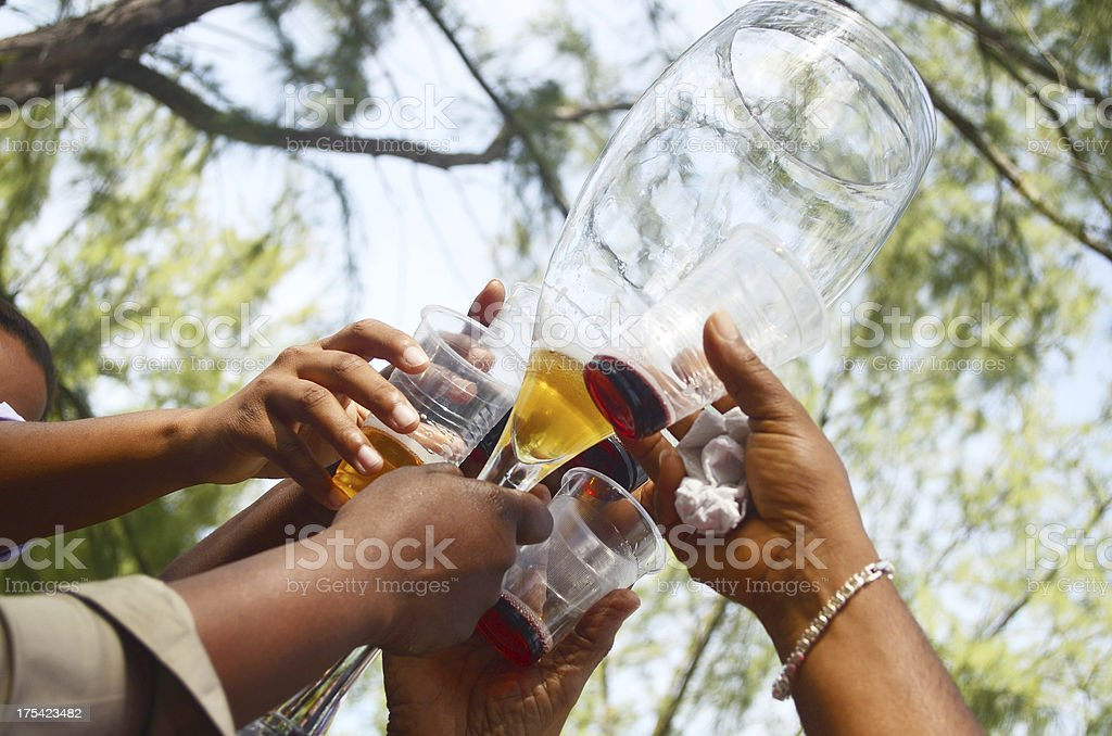 toast outdoors with giant champagne glass stock photo
