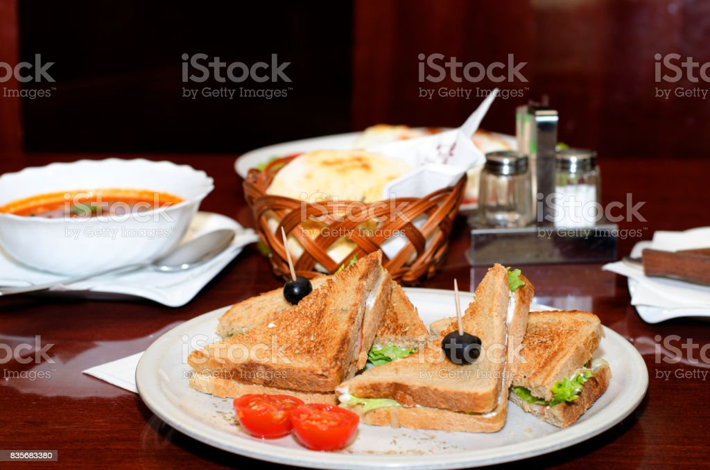 Toast sandwich with ham, vegetables and olives stock photo