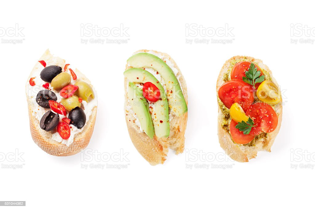 Toast sandwiches with avocado, tomatoes and olives stock photo
