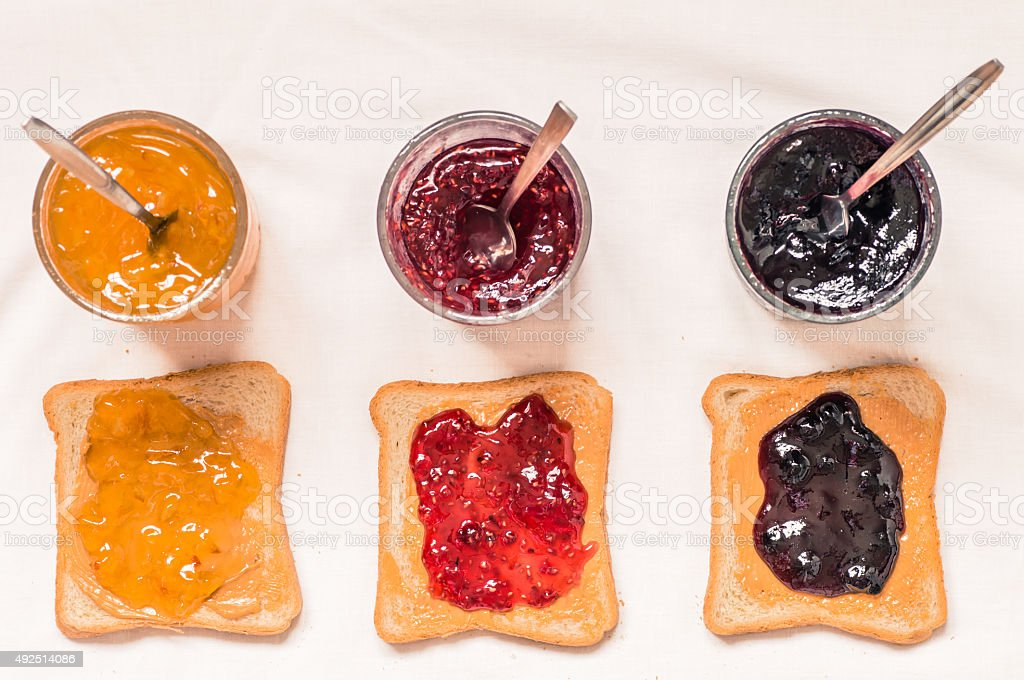 Toast sandwiches with peanut butter and jam stock photo