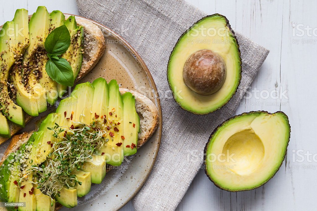Toast with avocado and cress stock photo