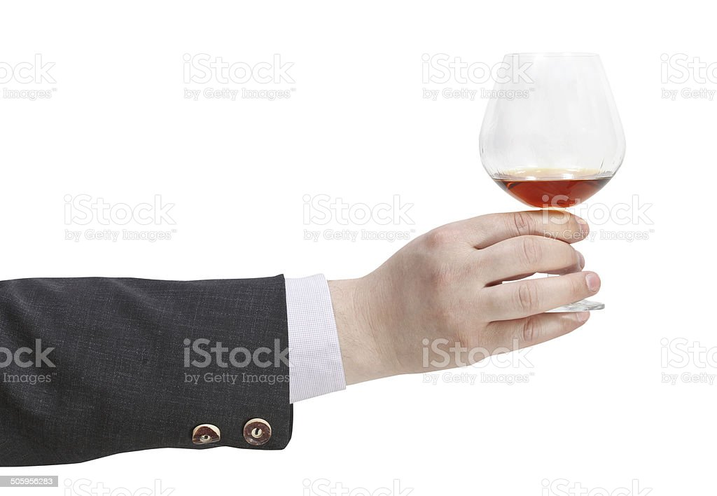 toast with brandy glass in businessman hand stock photo