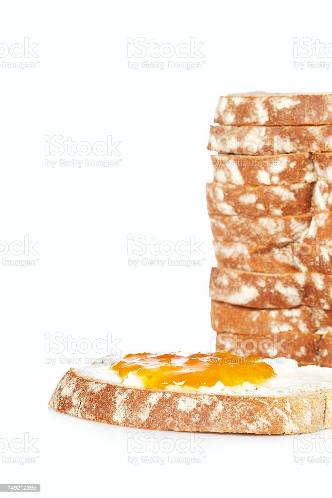 Toast with butter and peach jam royalty-free stock photo