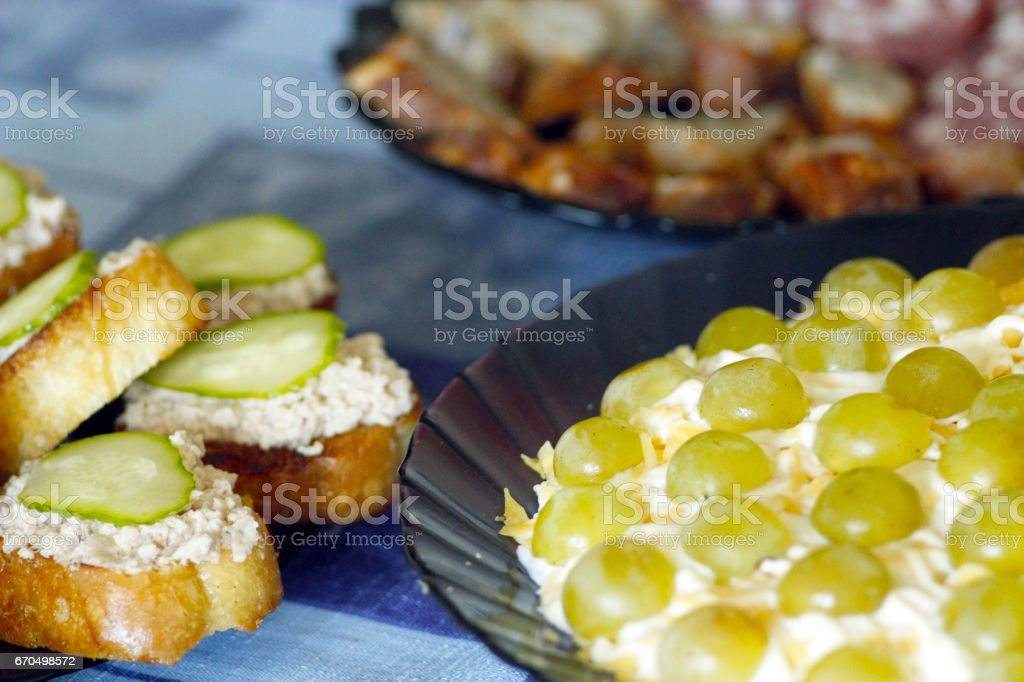 toast with cod's liver and salad with green grapes stock photo