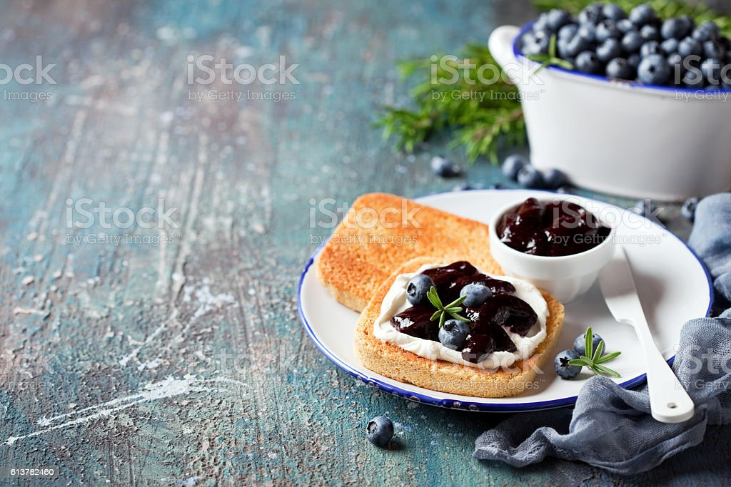 Toast with cream cheese and blueberry jam stock photo