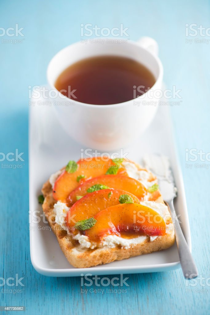 Toast with Goat Creem Cheese and Poached Nectarine stock photo