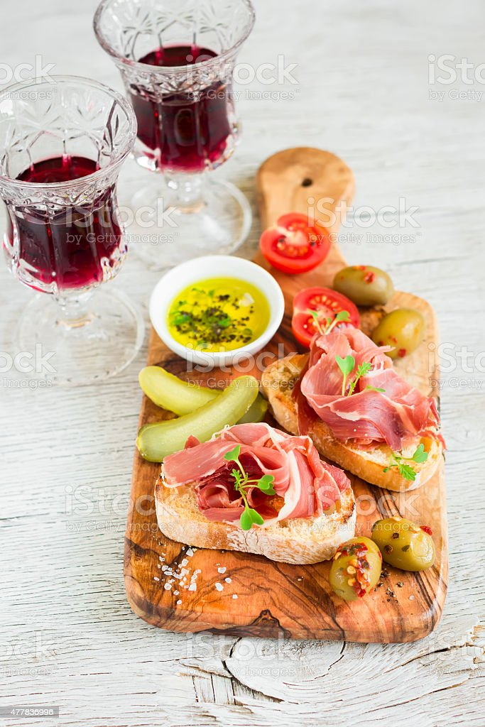 toast with ham, olives and cherry tomatoes in olive Board stock photo