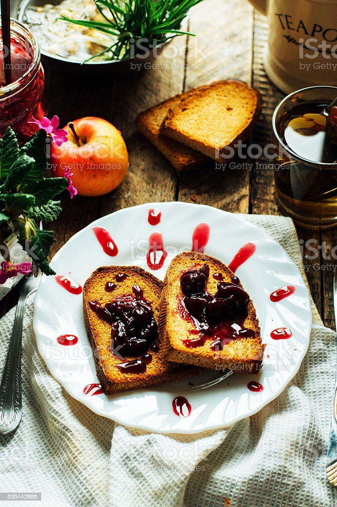 Toast with jam and cup of tea stock photo