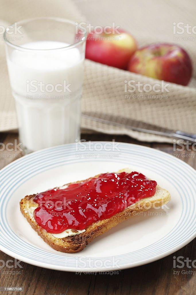 Toast with jam and milk stock photo