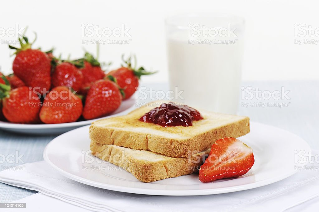 Toast with Marmelade Strawberry and Fresh Milk Breakfast stock photo