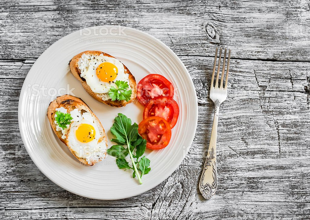toast with soft cheese and quail eggs stock photo