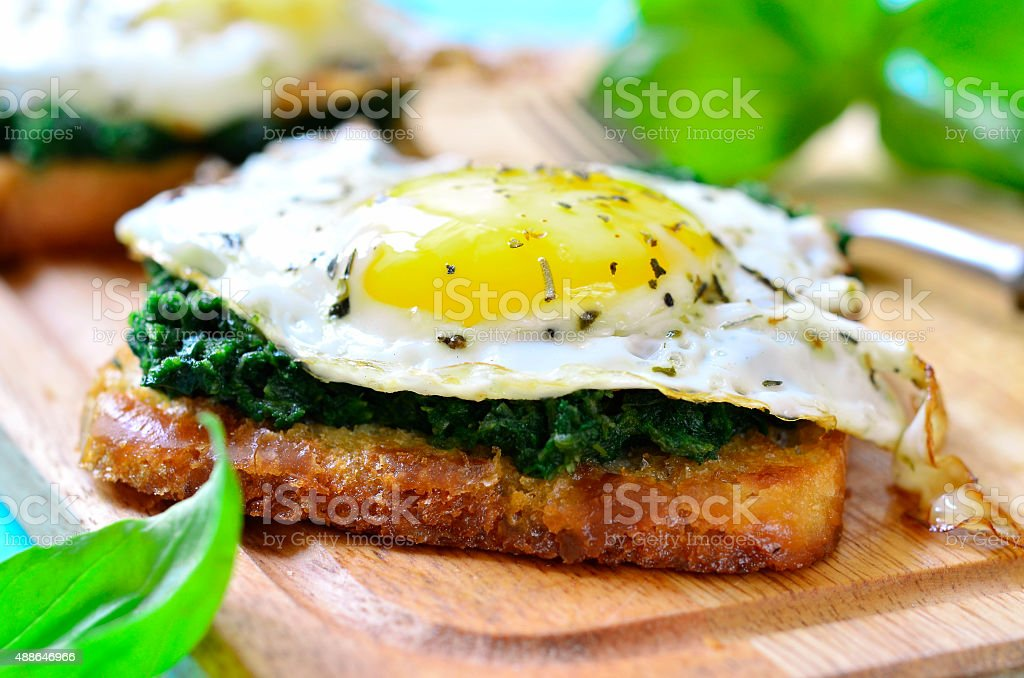 Toast with spinach and fried egg. stock photo