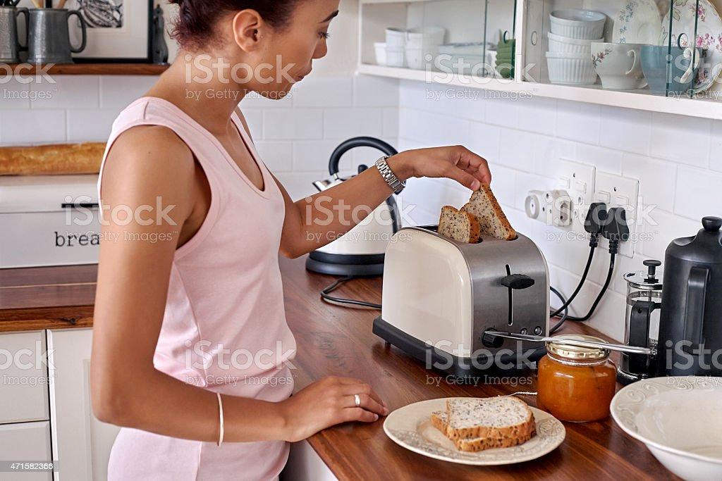 toast woman kitchen stock photo