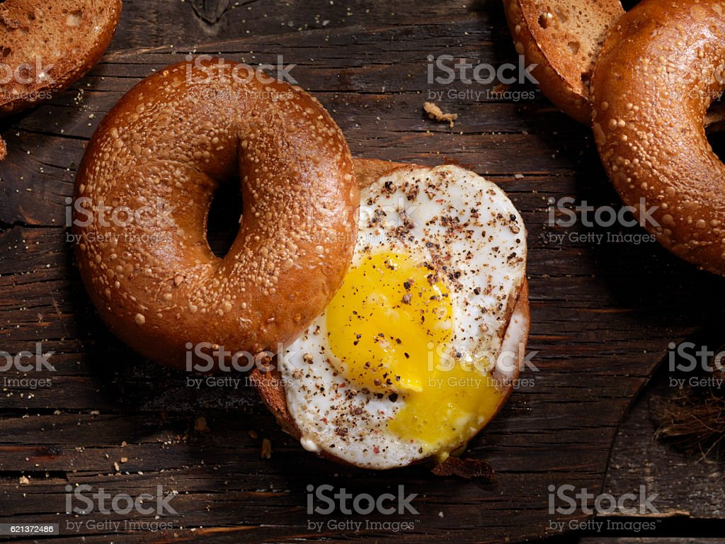 Toasted Bagel With a Sunnyside up Egg stock photo