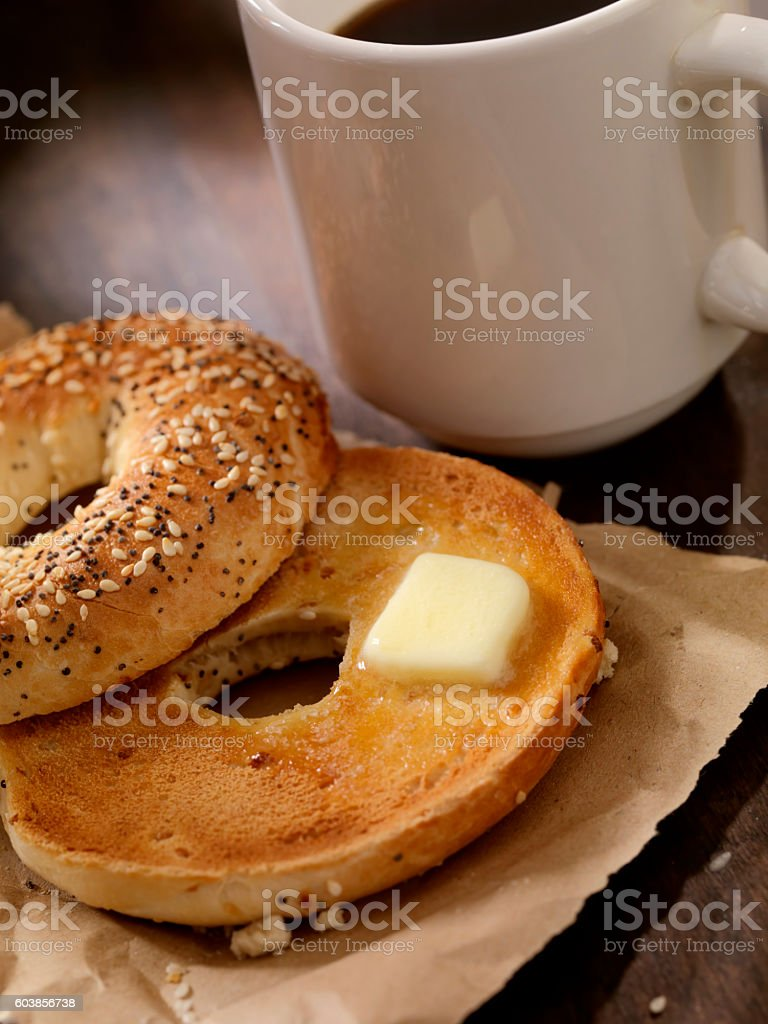 Toasted Bagel with Butter and a Coffee stock photo