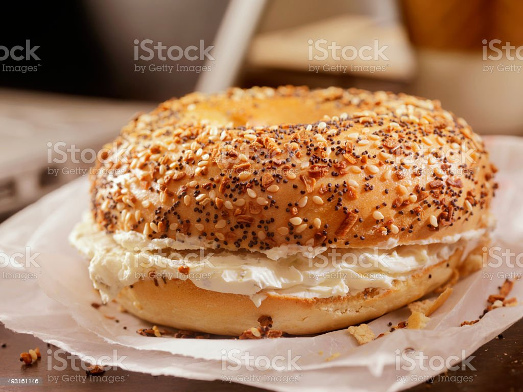Toasted Bagel with Cream Cheese at your Desk stock photo