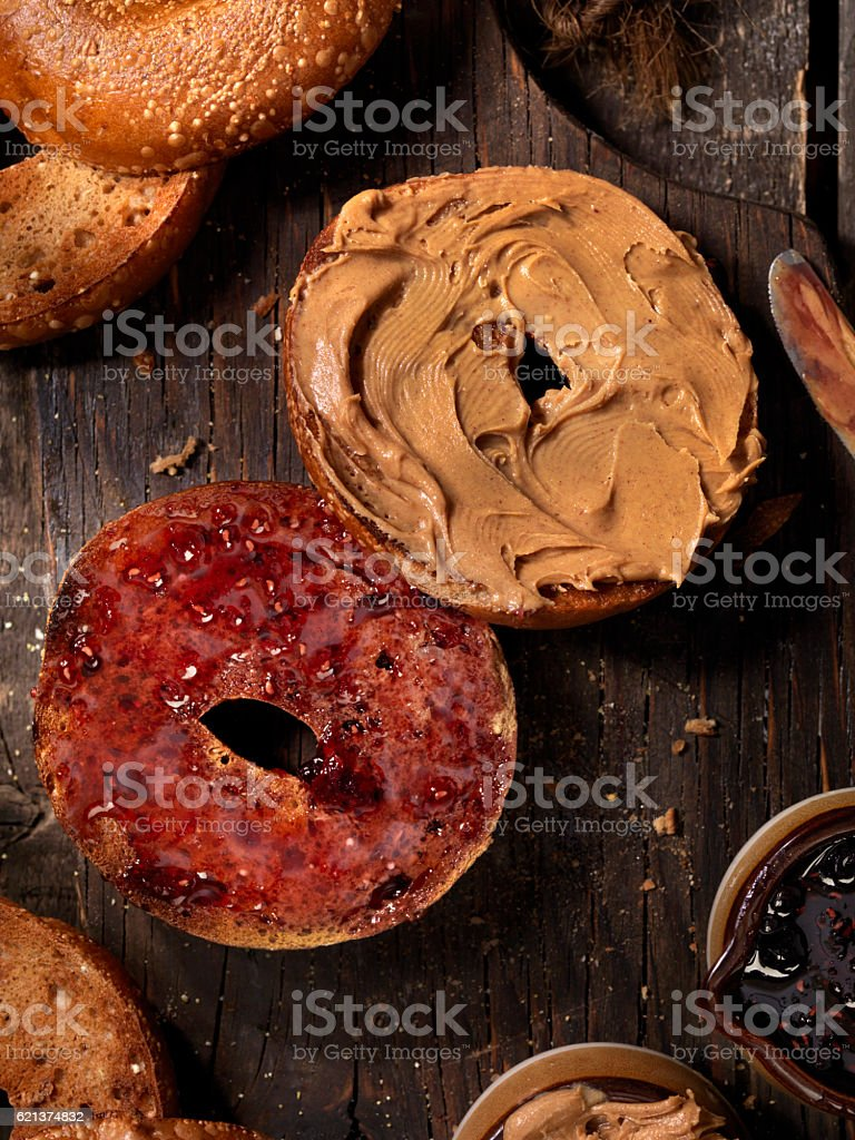Toasted Bagels with Peanut Butter and Jam stock photo