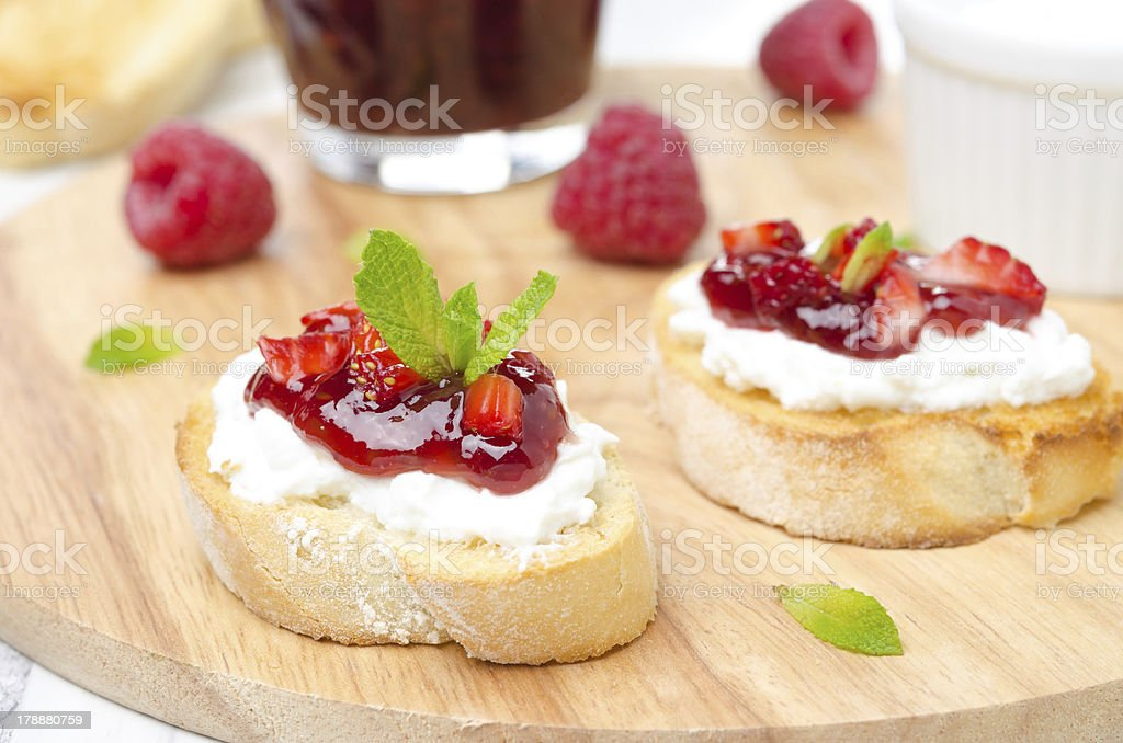 Toasted baguette with cream cheese, raspberry jam royalty-free stock photo