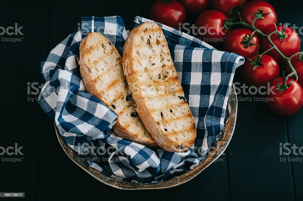 Toasted bread in bread basket stock photo