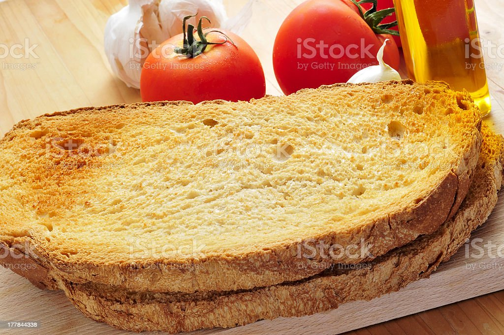 toasted bread slices, garlic, olive oil and tomato royalty-free stock photo