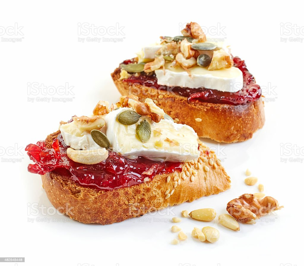toasted bread with brie and jam stock photo