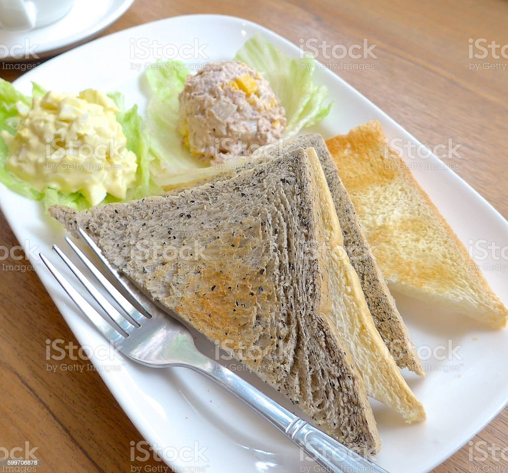 Toasted bread with egg salad closeup stock photo