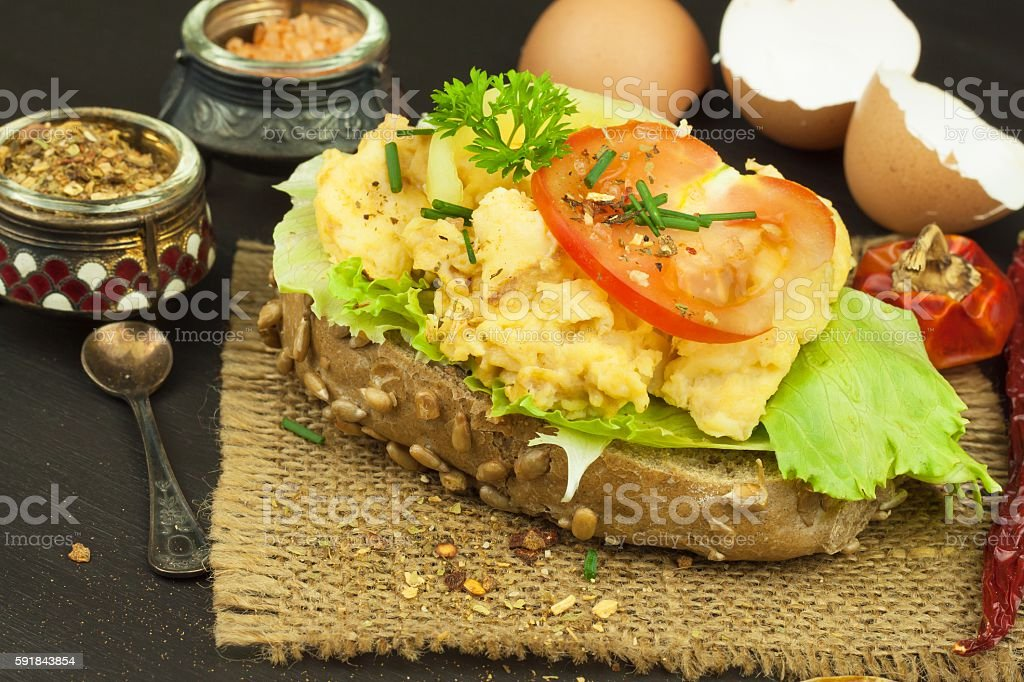 Toasted bread with scrambled eggs. stock photo