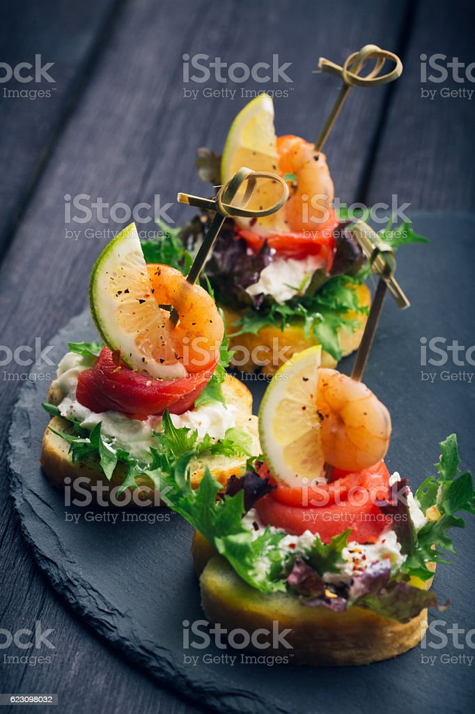 Toasted Canape with Shrimp and Salmon stock photo