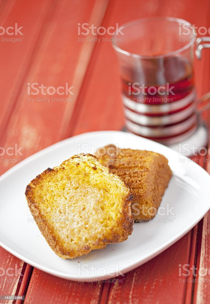 Toasted corn muffin with butter and a cup of tea royalty-free stock photo