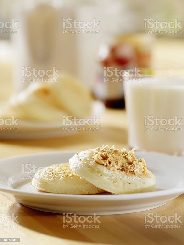 Toasted Crumpets with Peanut butter and Milk royalty-free stock photo
