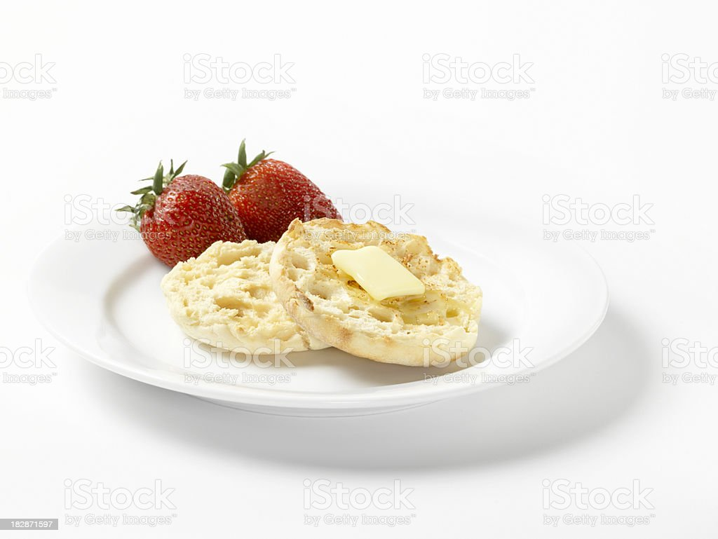 Toasted English Muffin with Butter and Strawberries stock photo
