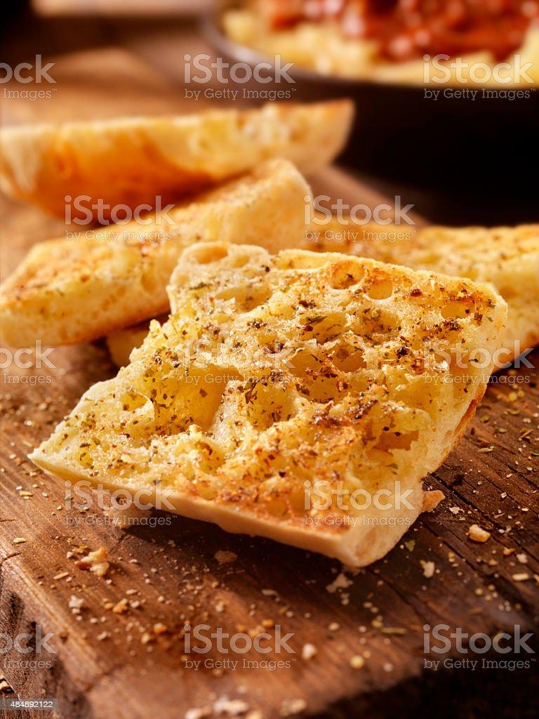 Toasted Garlic Ciabatta Bread on a Rustic Wood Cutting Board stock photo
