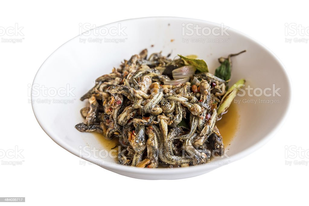 Toasted tadpoles with herbs in banana leaves stock photo