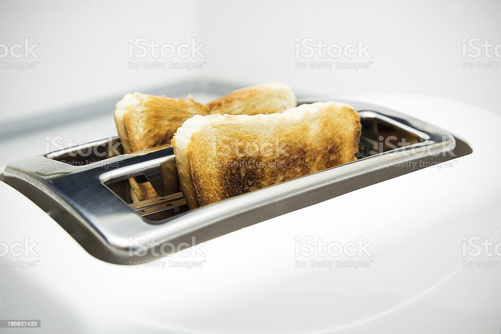 Toaster with bread slices on white background royalty-free stock photo