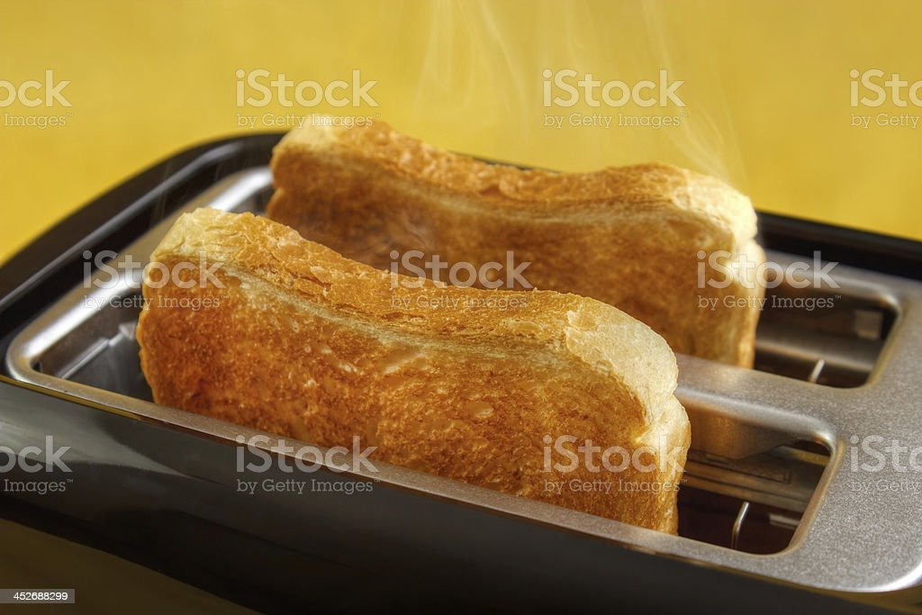 Toaster with toasts royalty-free stock photo