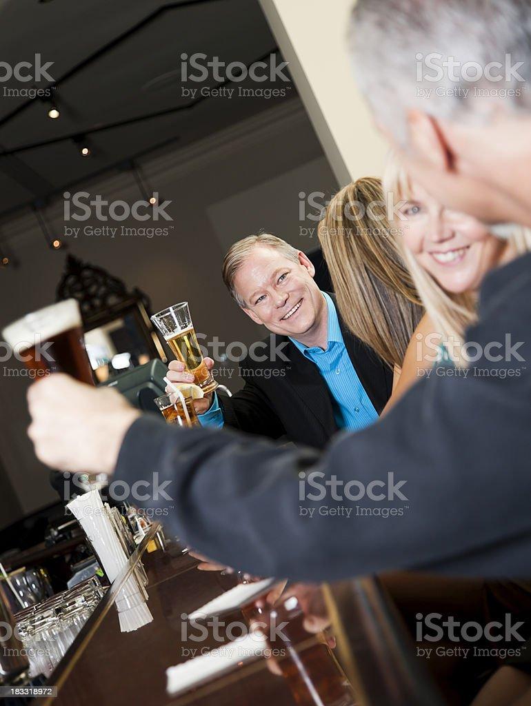 Toasting at a bar royalty-free stock photo